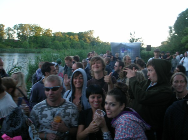 Junglist out and about feels okay in morning crowd. Signales to other junglist. Trentemøller's morning set at Dyssen's summer party, 2008.