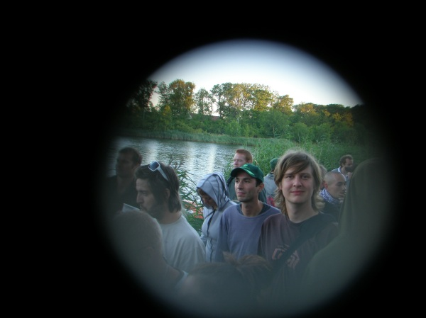 Junglist spots other Junglist through the crowd! I took this pic of Kristobal through a 5 kroner coin, just to experiment. This is at a summer party at Dyssen, Christiania. Trentemøller is playing a morning set. Secret Junglists blending in perfectly!
